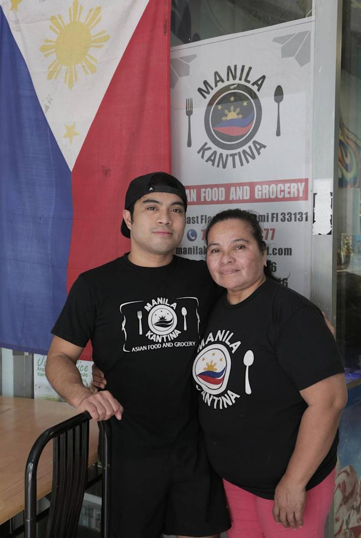 Judith Blasco, owner of Manila Kantina (right), and her son Petronio Blasco III (left) stand outside their restaurant Manila Kantina in downtown Miami on June 11, 2020.