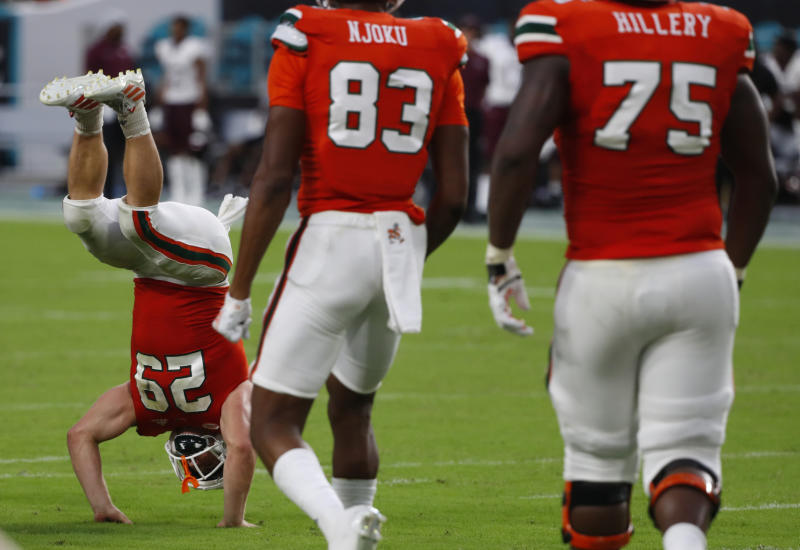 Miami defensive back Jimmy Murphy (29) celebrates after making a touch down during the second half of an NCAA college football game against Bethune-Cookman, Saturday, Sept. 14, 2019, in Miami Gardens, Fla. (AP Photo/Wilfredo Lee)