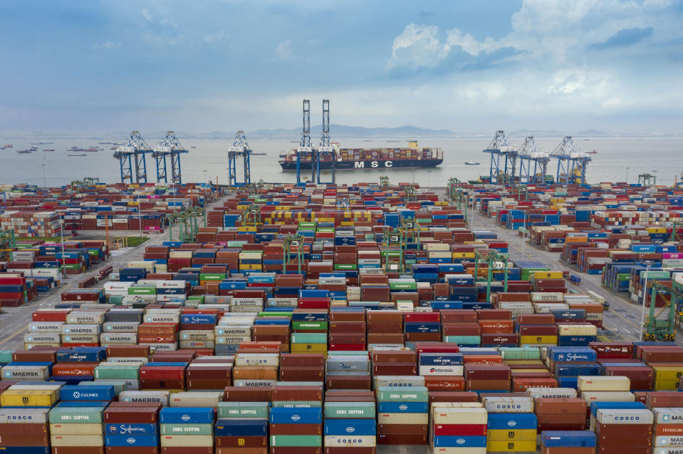 GUANGZHOU, CHINA - JUNE 08: Aerial view of shipping containers sitting stacked at Nansha Port, operated by Guangzhou Port Group Co., on June 8, 2021 in Guangzhou, Guangdong Province of China. (Photo by Qian Wenpan/Nanfang Daily/VCG via Getty Images)