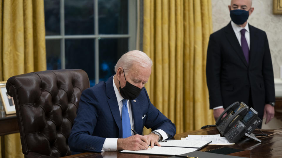 In this Tuesday, Feb. 2, 2021, file photo, Secretary of Homeland Security Alejandro Mayorkas looks on as President Joe Biden signs an executive order on immigration, in the Oval Office of the White House in Washington. (Evan Vucci/AP Photo)