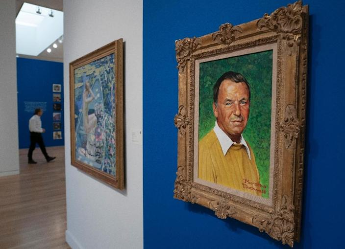A Norman Rockwell Portrait of Frank Sinatra was among belongings fans snapped up at Sotheby's (AFP Photo/Don EMMERT)