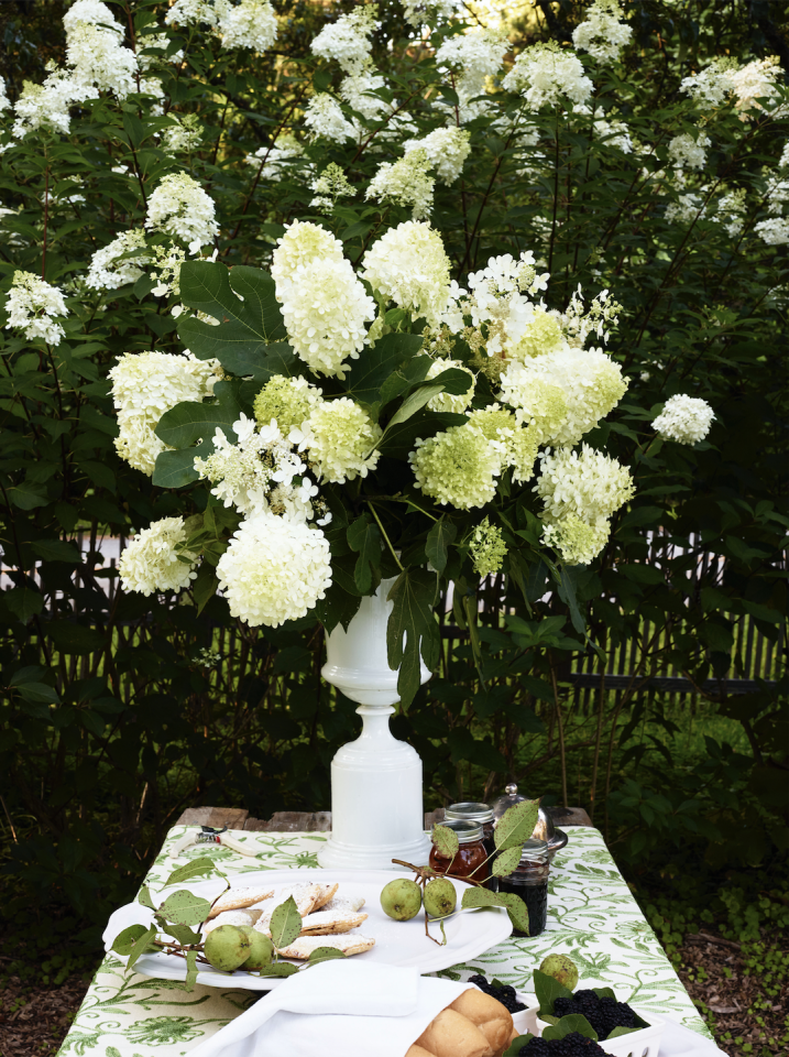 <p>Depending on the occasion, sometimes the most impactful arrangements are composed of just one type of bloom. Here, floral designer Keith Robinson used hydrangea paniculata to tower over this buffet and lend a natural, but elegant, air to the afternoon gathering. </p>