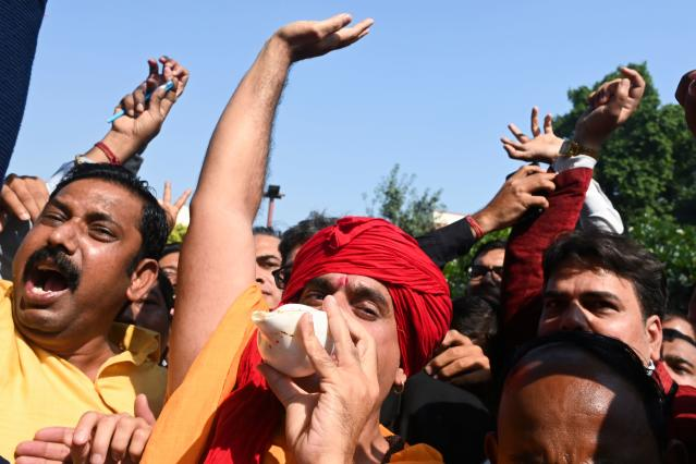 All India Hindu Mahasabha president Chakrapani Maharaj and supporters celebrate at the Supreme Court in New Delhi on November 9, 2019, after a ruling over a holy site contested for centuries by Hindus and Muslims. - India's top court handed on November 9 a huge victory to Prime Minister Narendra Modi's Hindu nationalist ruling party by awarding Hindus control of a bitterly disputed holy site that has sparked deadly sectarian violence. (Photo by Money SHARMA / AFP) (Photo by MONEY SHARMA/AFP via Getty Images)