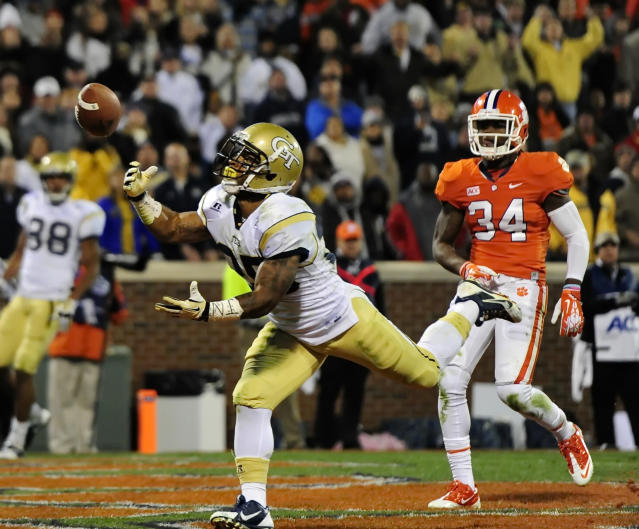 While covered by Clemson's Quandon Christian, right, Georgia Tech's Robert Godhigh comes up short in the closing seconds of the first half of an NCAA college football game on Thursday, Nov. 14, 2013, in Clemson, S.C.(AP Photo/ Richard Shiro)