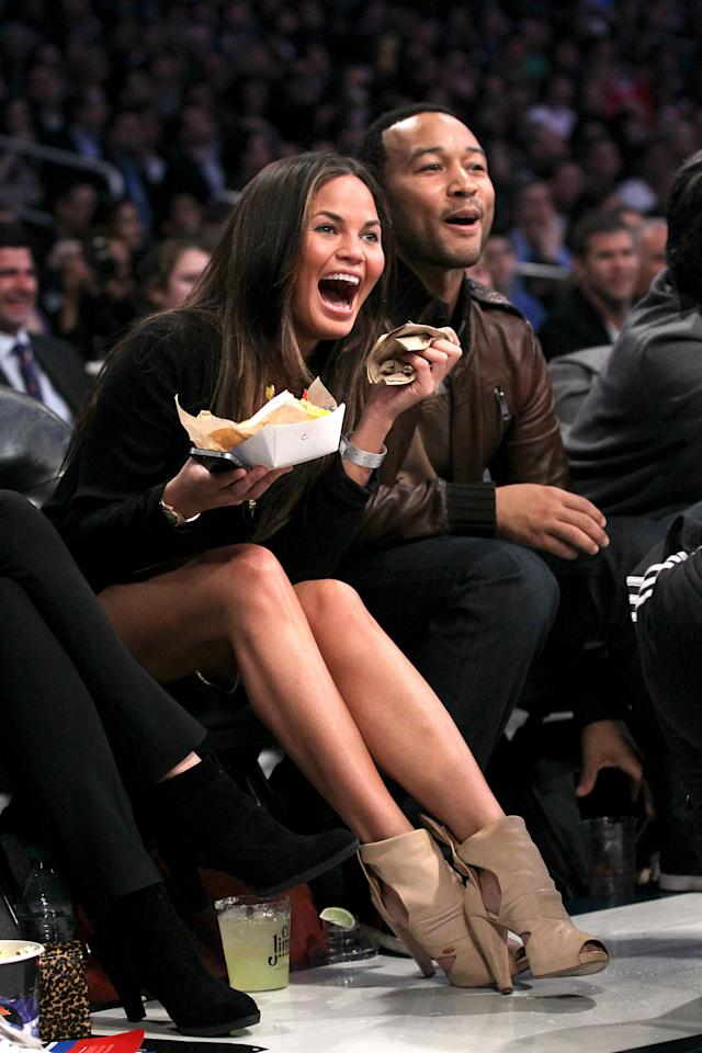 Chrissy Teigen and John Legend attend the 2011 NBA All-Star game.