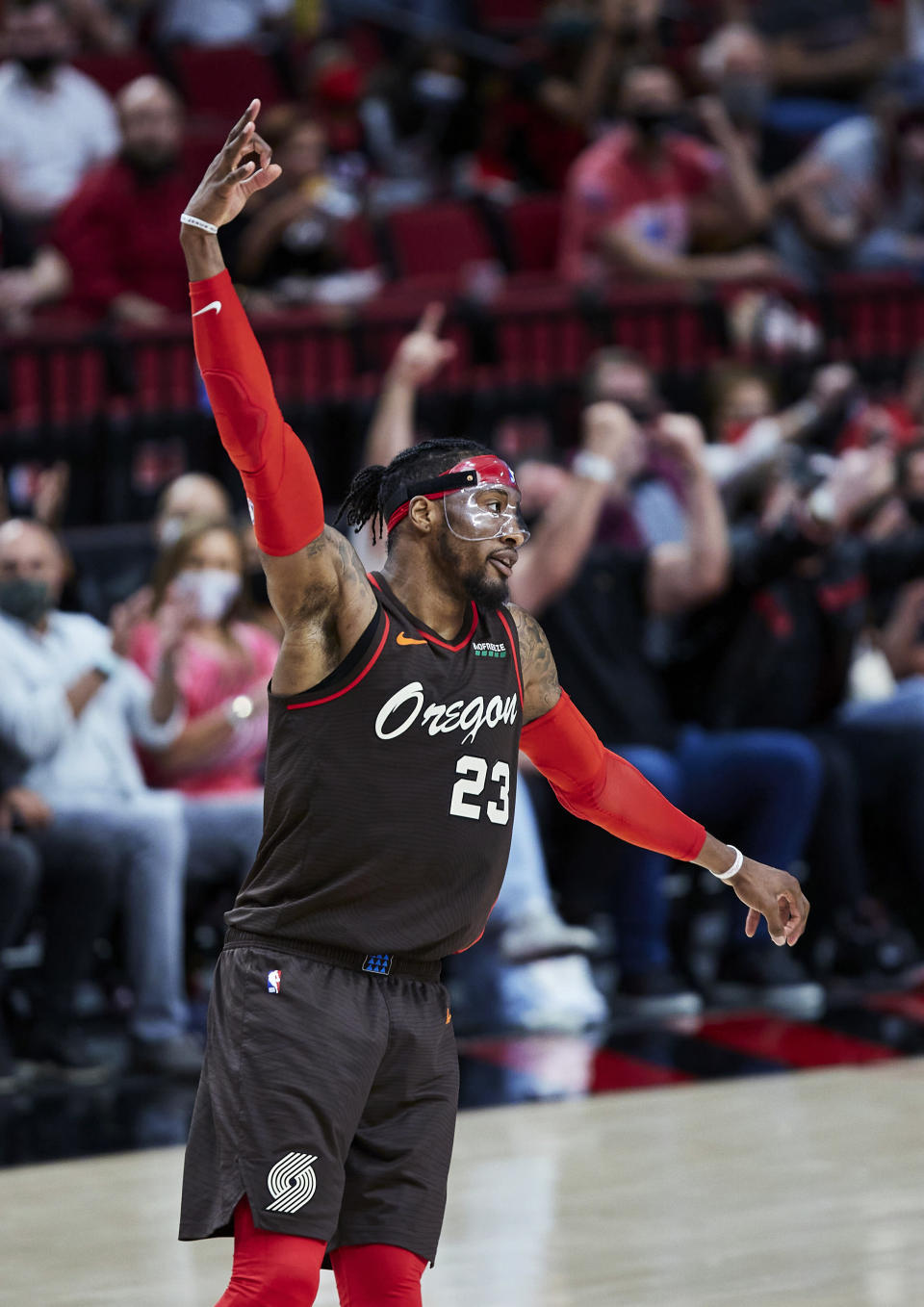 Portland Trail Blazers forward Robert Covington reacts after making a 3-point basket against the Denver Nuggets during the second half of Game 6 of an NBA basketball first-round playoff series Thursday, June 3, 2021, in Portland, Ore. (AP Photo/Craig Mitchelldyer)