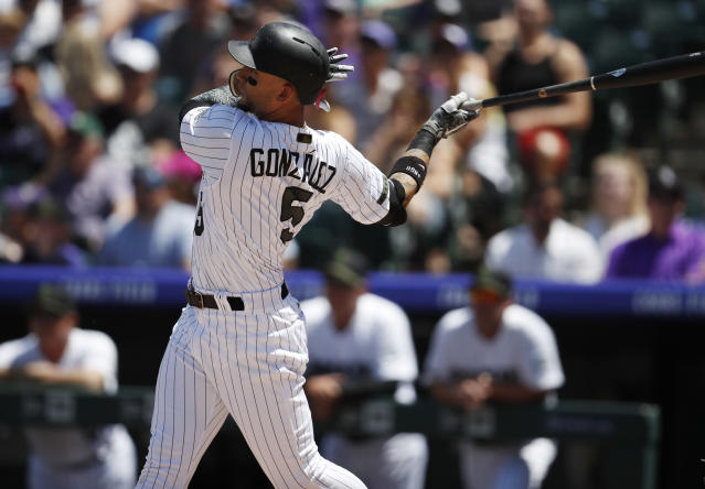 Colorado Rockies' Carlos Gonzalez follows the flight of his two-run home run off Cincinnati Reds starting pitcher Matt Harvey in the first inning of a baseball game Sunday, May 27, 2018, in Denver. (AP Photo/David Zalubowski)