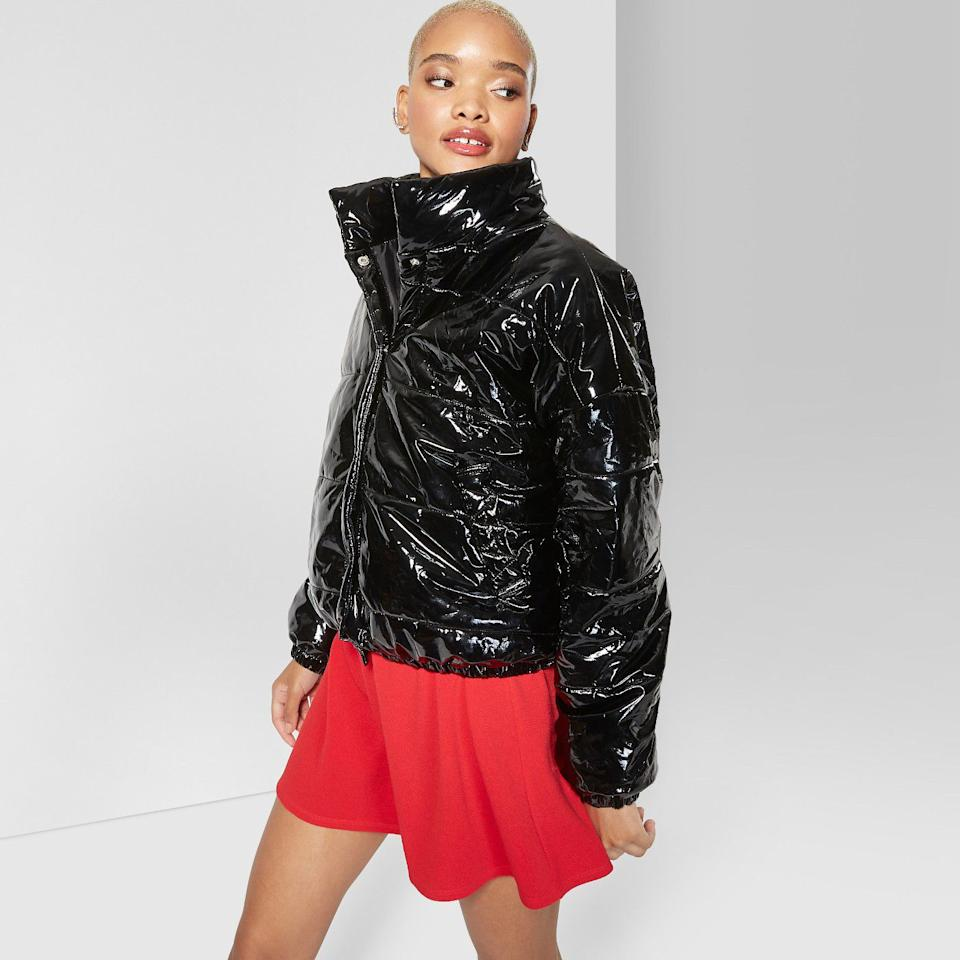 """<p><strong>Wild Fable™</strong></p><p>target.com</p><p><strong>$40.00</strong></p><p><a rel=""""nofollow"""" href=""""https://www.target.com/p/women-s-drop-shoulder-zip-up-puffer-jacket-wild-fable-153-black/-/A-53767374"""">Shop Now</a></p><p>The high collar, the shiny sheen, the cropped fit – this jacket is for risk-takers only. <em></em></p>"""