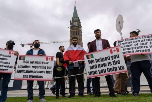 About 60 formerinterpreters who assisted the Canadian Armed Forces in Afghanistan started a hunger strike onParliament Hill on Wednesday. (Francis Ferland/CBC - image credit)