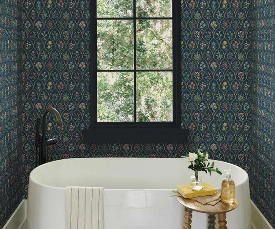 """We've all seen florals live on lighter or pastel backgrounds, which makes this botanical print on navy so eye-catching. This wallpaper is also available in black, rose, green, and gold. Shop Rifle Paper Co. for more wallpapers, plus plenty of wall art and additional home decor. $110, Rifle Paper Co.. <a href=""""https://riflepaperco.com/hawthorne-navy-multi-wallpaper-roll"""" rel=""""nofollow noopener"""" target=""""_blank"""" data-ylk=""""slk:Get it now!"""" class=""""link rapid-noclick-resp"""">Get it now!</a>"""