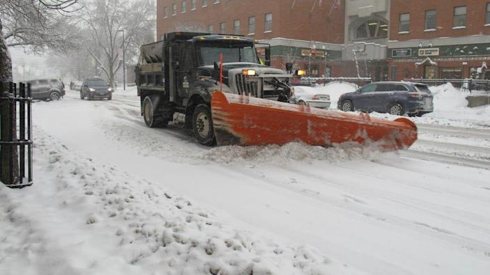 A city plow helps keep city streets clear of snow on Feb. 7, 2020, in Montpelier, Vt. More snow is forecast this week from the Midwest to norrthern New England.
