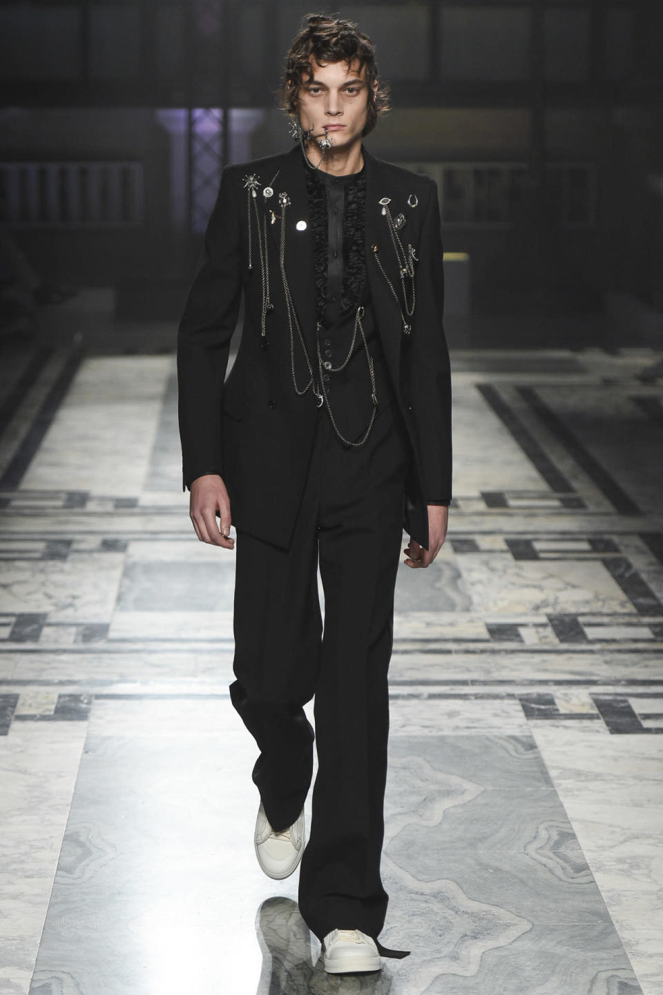 <p>Mixing the tailoring and precision of the Victorian military uniforms with the punk era, designer, Sarah Burton's Fall 2016 collection for Alexander McQueen was piercing to say the least.<i> Photo: Getty Images</i></p>