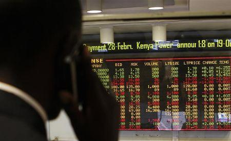 A stockbroker transacts shares during a trading session at the Nairobi Securities Exchange in Nairobi