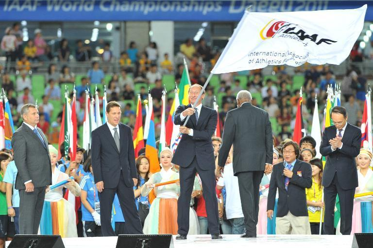 Valentin Balakhnichev, then president of the All-Russia Athletics Federation, waves the IAAF flag during a ceremony in Daegu on September 4, 2011 (AFP Photo/Kim Jae-Hwan)