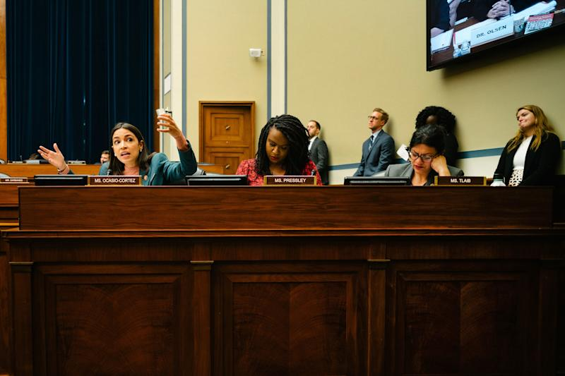 """Ocasio-Cortez, left, Rep. Ayanna Pressley (D-MA), center, and Rep. Rashida Tlaib (D-MI), right, sit together at the Committee for Oversight and Reform. Ocasio-Cortez takes her turn to speak to a panel of witnesses at a hearing entitled """"Medical Experts: Inadequate Federal Approach to Opioid Treatment and the Need to Expand Care."""""""