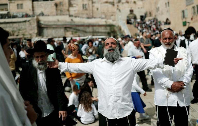 Jews take part in the Passover priestly blessing at the Western Wall in Jerusalem, on April 13, 2017