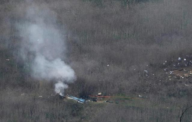 (FILES) In this file photo taken on January 26, 2020 smoke rises from the site of a helicopter crash in Calabasas, California that killed 9 people including former Los Angeles Laker Kobe Bryant. (AFP Photo/Mark RALSTON)