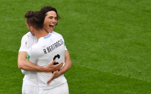 Edinson Cavani (L) celebrates with Uruguay's midfielder Rodrigo Bentancur (R) after Uruguay's defender Jose Gimenez scored the opening goal during the Russia 2018 World Cup Group A football match between Egypt and Uruguay - Credit: GETTY IMAGES