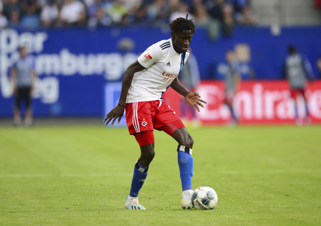 FILE - In this Aug. 16, 2019 file photo, Hamburg's Bakery Jatta plays during the 2. Bundesliga match between Hamburg SV and VfL Bochum in Hamburg, Germany. Hamburger SV has reinforced its support for midfielder Bakry Jatta as the dispute over his identity continues to inflame tempers in Germanys second division. The affair began with a report by Sport Bild magazine suggesting that Jatta who became the first refugee to play in the Bundesliga when he made his debut for Hamburg in April 2017 has been playing under a false name and is in fact two years older than he claims to be. (Daniel Bockwoldt/dpa via AP)