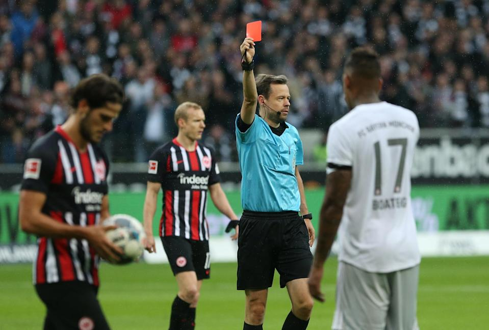Bayern Munich's Jerome Boateng (17) is shown a red card during Eintracht Frankfurt's 5-1 victory on Saturday. (Getty)