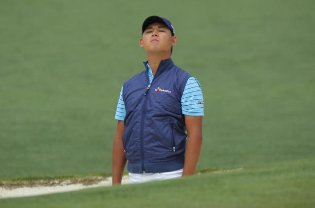Kim Si-Woo of South Korea looks at his ball after hitting from the sand on the second hole during final round play of the 2018 Masters golf tournament at the Augusta National Golf Club in Augusta, Georgia, U.S. April 8, 2018. REUTERS/Brian Snyder