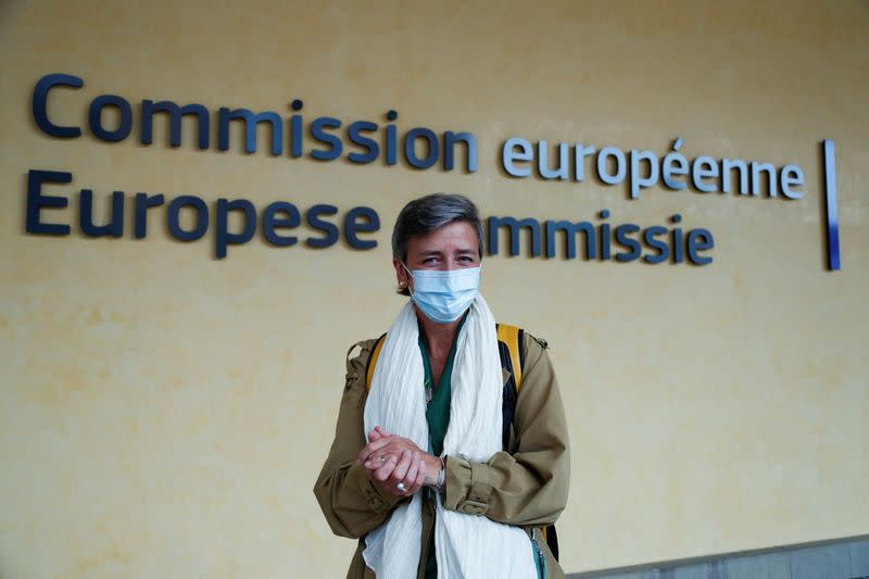 European Competition Commissioner Margrethe Vestager wearing a protective mask leaves the EU Commission headquarters in Brussels