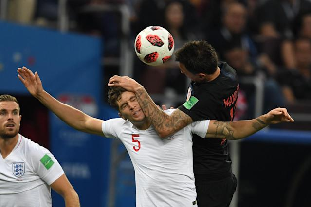 <p>Croatia's forward Mario Mandzukic (R) heads the ball with England's defender John Stones the Russia 2018 World Cup semi-final football match between Croatia and England at the Luzhniki Stadium in Moscow on July 11, 2018. (Photo by Kirill KUDRYAVTSEV / AFP) </p>