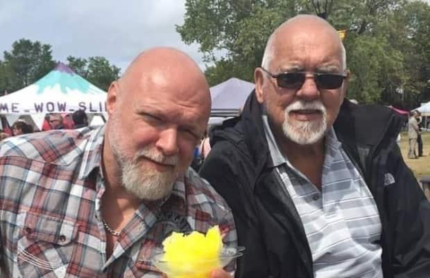 Mike Pitre, left, with his father, Leonda, who has vascular dementia. Pitre, who lives in Quebec, filed a request with the government to visit New Brunswick through proper channels put in place during the COVID-19 pandemic, but his application was denied. (Submitted by Mike Pitre - image credit)