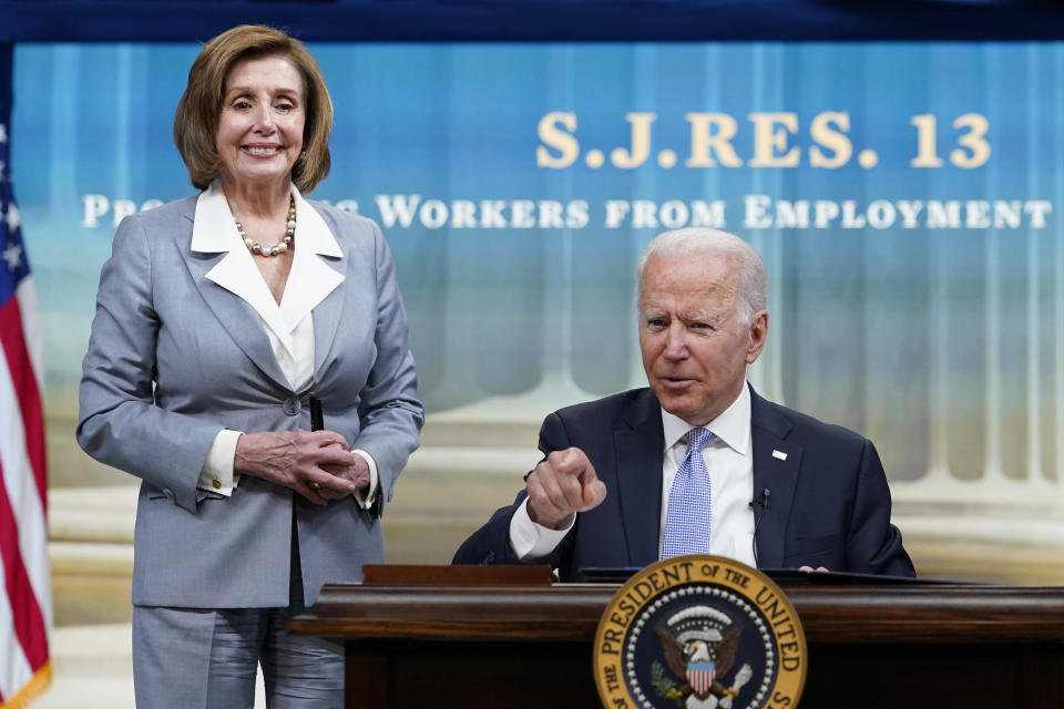 President Joe Biden, joined by House Speaker Nancy Pelosi of Calif., talks in-between signing signs several bills during an event in the South Court Auditorium on the White House complex in Washington, Wednesday, June 30, 2021. (AP Photo/Susan Walsh)