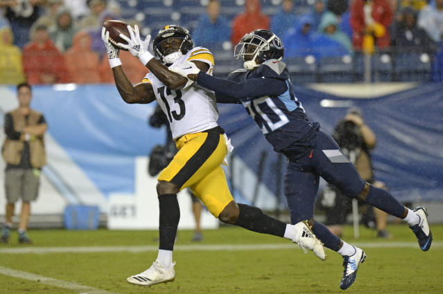 Pittsburgh Steelers wide receiver James Washington (13) catches a 41-yard touchdown as he is defended by Tennessee Titans defensive back Kenneth Durden (20) in the first half of a preseason NFL football game Sunday, Aug. 25, 2019, in Nashville, Tenn. (AP Photo/Mark Zaleski)