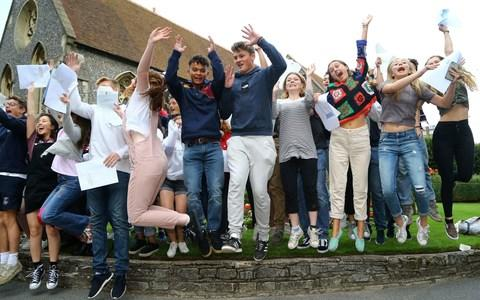 Students at Brighton College celebrate after opening their exam results - Credit: Gareth Fuller/PA