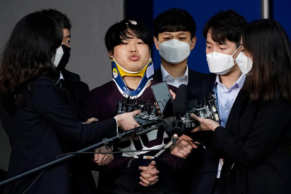 <p>Cho Ju-bin, centre, leader of South Korea's largest online sexual blackmail ring, pictured outside a police station in March</p> (AP)