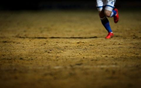 """Mauricio Pochettino, the Tottenham Hotspur manager, has said that Rochdale's sand-covered pitch is not fit to host their fifth-round match later this month. Spurs are due to travel to Spotland on Sunday week after Rochdale defeated Millwall in an FA Cup replay on Tuesday. Neil Harris, the Millwall manager, said after the game the pitch was the worst he had ever seen. And Pochettino, who has seen pictures of the surface, believes both sets of players would be at risk of injury if they were to play at Spotland. The Spurs manager also called on the Football Association to assess the surface before allowing any match to take place. """"I think the FA need to assess how the pitch is and then to take a decision about if it's good for the FA Cup, good for the players, good for the teams to play in this type of pitch,"""" Pochettino said. """"In that condition I think it does not help football. Pochettino is chasing his first trophy as a manager Credit: Getty images """"I don't know why what happened, happened with this pitch but it is true that the picture [I have seen], I think it is not a pitch in a condition to play football."""" Asked if he was worried about his players picking up injuries, Pochettino said: """"Yes, but I think the opponent, too. I think it is a big risk to play in a pitch like this, if the pictures I have seen give an accurate impression of the state of it. """"If it is like I saw in the pictures, I think you cannot play football on it. That is my point of view. But not because we are Tottenham. No, I think Rochdale cannot play football there, too. And it's a massive risk for their players, too. Sand covers the Rochdale pitch Credit: Getty images """"Maybe the FA need to go in and try to take a very good decision for football, not only because we have to go and play there."""" Pochettino added that he would speak to Spurs chairman Daniel Levy to """"see if we can find some solutions"""". It is understood that it is unlikely the venue of the game would be switched by the FA, which exp"""