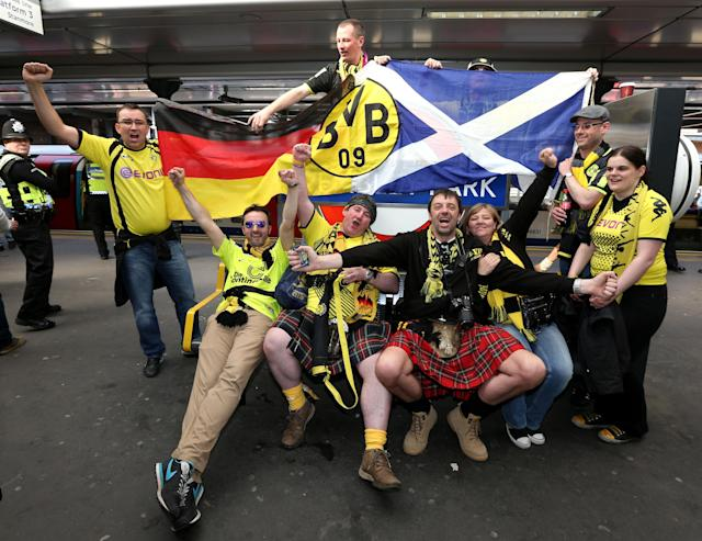 Borrussia Dortmund's fans pose for photographs at Wembley Park tube station before the Champions League Final at Wembley, London.