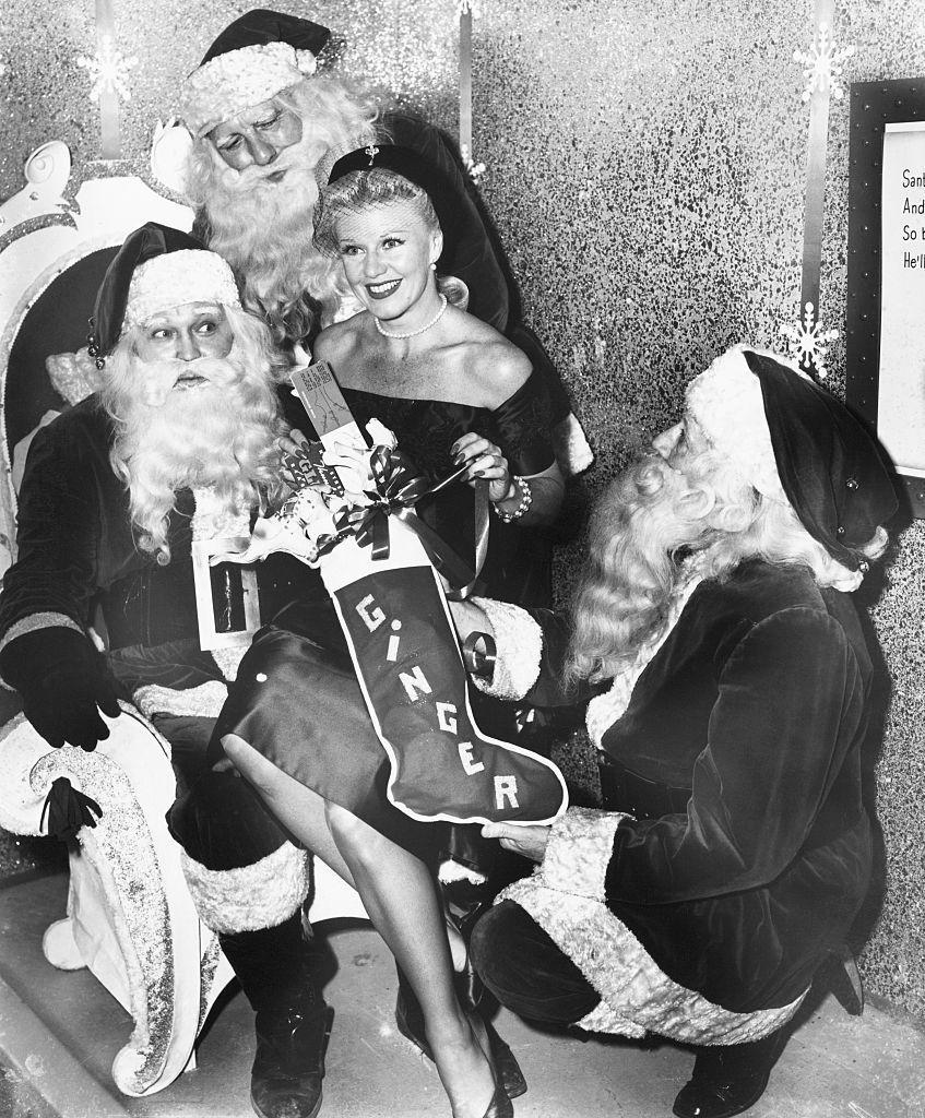 <p>Judging by how many Santas are gathered around actress Ginger Rogers, we'd say she was nice that year. </p>