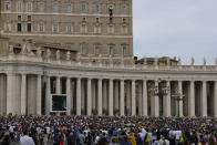 Faithful and pilgrims listen to Pope Francis' speech during the Angelus noon prayer from the window of his studio overlooking St.Peter's Square, at the Vatican, Sunday, Oct. 3, 2021. (AP Photo/Alessandra Tarantino)