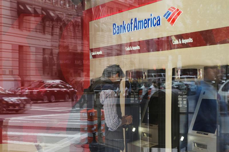 FILE PHOTO: Customer uses an ATM at a Bank of America branch in Boston
