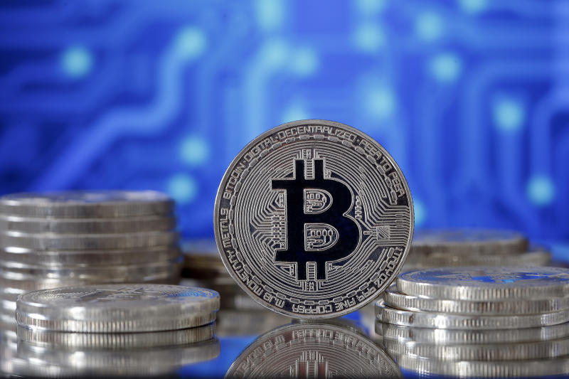 PARIS, FRANCE - JUNE 25: In this photo illustration, a visual representation of the digital Cryptocurrency, Bitcoin is displayed on June 25, 2019 in Paris, France. Bitcoin surpassed the 11,000 dollar mark Monday, Facebook's arrival on the cryptocurrency market with Libra has boosted global interest around the various currencies in circulation. Bitcoin has reached its highest level since March 5, 2018. (Photo by Chesnot/Getty Images)
