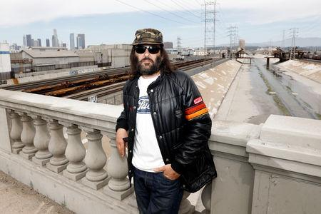 "Erik Brunetti, Los Angeles artist and streetwear designer of the clothing brand FUCT, stands for a portrait in Los Angeles, California, U.S., April 7, 2019. The Supreme Court will hear the U.S. Patent and Trademark Office's appeal of a lower court decision that the agency should have allowed Brunetti to trademark the ""FUCT"" brand name. Picture taken April 7, 2019.  REUTERS/Patrick T. Fallon"