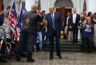 President Donald Trump greets cheering members of Bikers for Trump and supporters, Saturday, Aug. 11, 2018, at the clubhouse of Trump National Golf Club in Bedminster, N.J. (AP Photo/Carolyn Kaster)