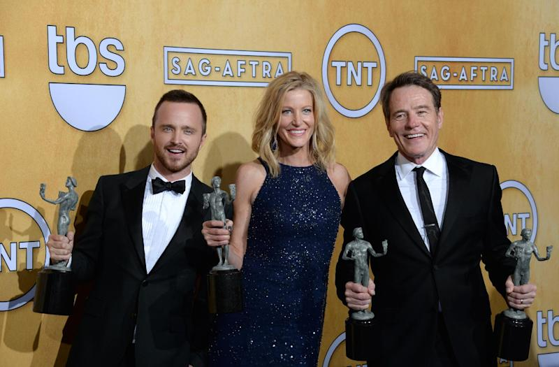 "From left, Aaron Paul, Anna Gunn and Bryan Cranston, members of the cast of ""Breaking Bad,"" winner of the Best Ensemble in a Drama Series, pose at the 20th annual Screen Actors Guild Awards on January 18, 2014 in Los Angeles, California (AFP Photo/Joe Klamar)"