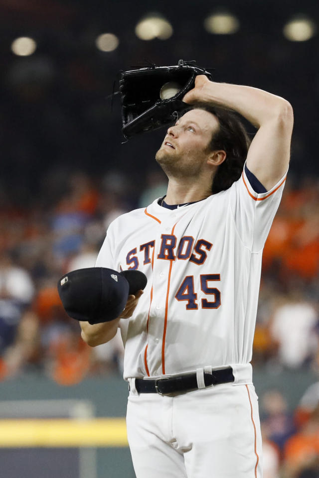 Houston Astros starting pitcher Gerrit Cole wipes his fave after giving up a double to Washington Nationals' Juan Soto during the fifth inning of Game 1 of the baseball World Series Tuesday, Oct. 22, 2019, in Houston. (AP Photo/Matt Slocum)