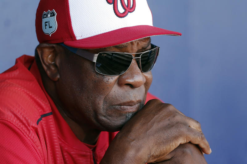 FILE - In this March 11, 2017, file photo, Washington Nationals manager Dusty Baker talks to reporters in the dugout before playing New York Mets in a spring training baseball game, in Port St. Lucie, Fla.  A person with knowledge of the negotiations said Tuesday, Jan. 28,2 020, that Baker, 70,  is working to finalize an agreement to become manager of the Houston Astros. The person spoke on condition of anonymity because the deal has not yet been completed. (AP Photo/John Bazemore, File)