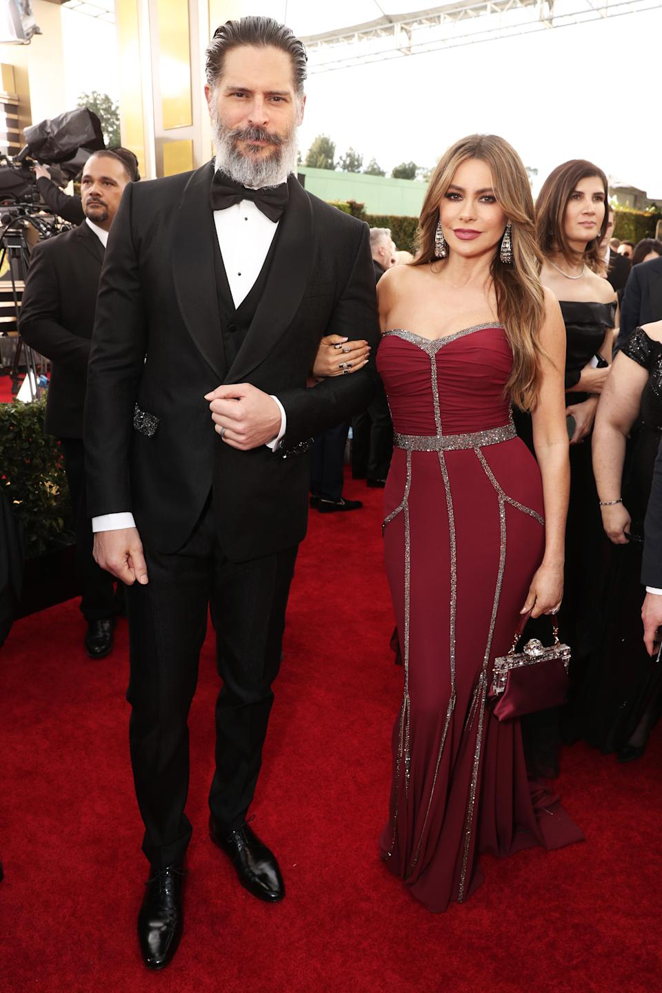 Vergara and her bearded husband sizzled in a crimson gown, with a ruched bodice. (Photo by: Todd Williamson/NBC/NBCU Photo Bank via Getty Images)