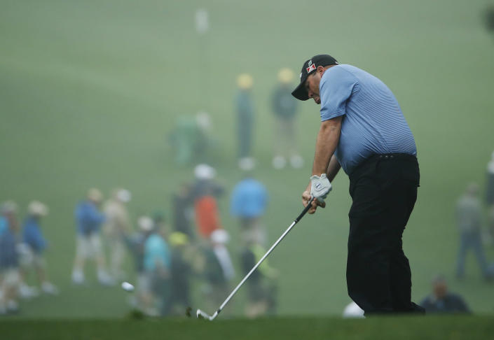 Kevin Stadler hits off the first fairway during a practice session for the Masters golf tournament Monday, April 7, 2014, in Augusta, Ga. (AP Photo/Matt Slocum)