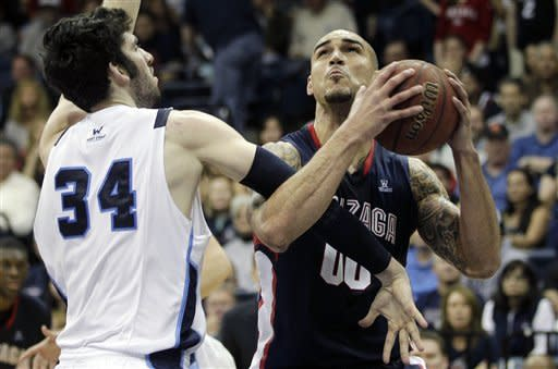 Gonzaga's Robert Sacre, right, is fouled by San Diego's Chris Manresa (34) in the second half of an NCAA college basketball game Saturday, Feb. 25, 2012, in San Diego. Gonzaga won, 65-57. (AP Photo/Gregory Bull)