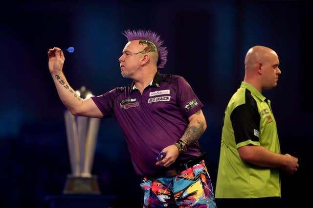Van Gerwen (right) had no answer to Wright (Steven Paston/PA)