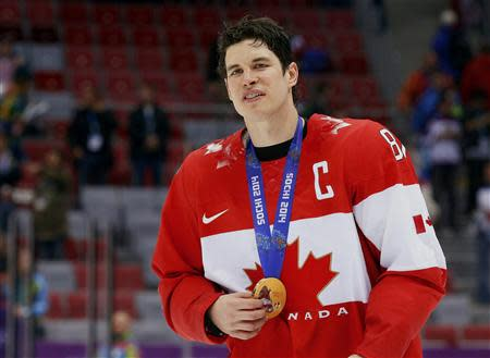 Canada's Sidney Crosby holds his gold medal at the victory ceremony for the men's ice hockey competition at the Sochi 2014 Winter Olympic Games