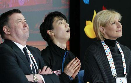 Figure Skating - ISU World Championships 2017 - Men's Free Skating - Helsinki, Finland - 1/4/17 - Yuzuru Hanyu (C) of Japan and his team members react after the performance. REUTERS/Grigory Dukor