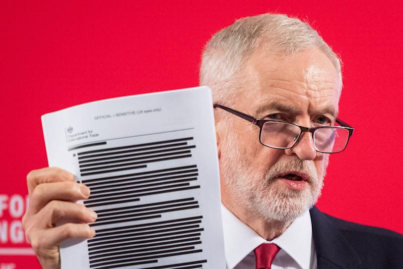 Labour leader Jeremy Corbyn holds a redacted copy of the Department for International Trade's UK-US Trade and Investment Working Group report following a speech about the NHS, in Westminster, London. (Photo by Dominic Lipinski/PA Images via Getty Images) (Photo: Dominic Lipinski - PA Images via Getty Images)